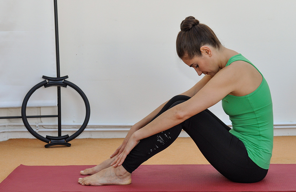 Körper Kontrolle beim Pilates Training